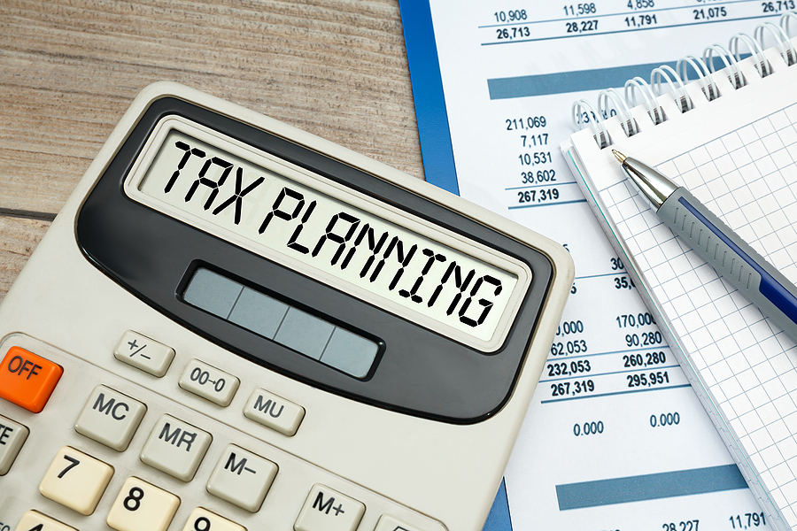 A calculator and other sheets needed for tax planning